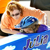 WARREN DILLAWAY / Star Beacon<br /> DIANA WELTON assists Julia Welton, 7, on Saturday during the Soap Box Derby in Conneaut.