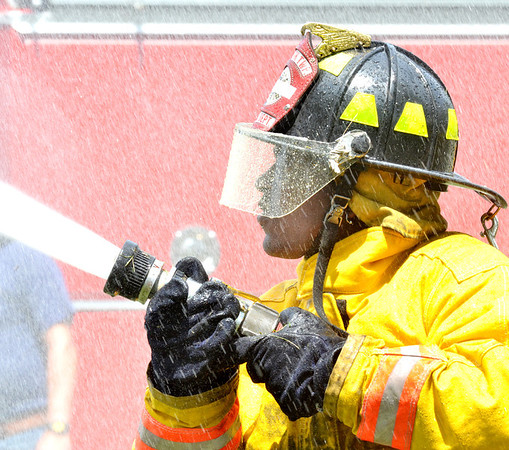 WARREN DILLAWAY / Star Beacon<br /> MIKE WOFFORD was part of a three man team from the Plymouth Township Fire Department Saturday during the Firefighter Roundup at the Geneva-on-the-Lake Landing.