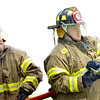 WARREN DILLAWAY / Star Beacon<br /> BOB VANSICKLE 9right) and Jonathan Richardson were part of a three man team from the Plymouth Township Fire Department Saturday during the Firefighter Roundup at the Geneva-on-the-Lake Landing.