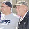 WARREN DILLAWAY / Star Beacon<br /> BILL LAVECK (left) and his father Tom watch Lauren Laveck race down Broad Street hill on Saturday during the Soap Box Derby in Conneaut Saturday. Tom Laveck participated in the first race in Ashtabula County 60 years ago.