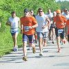 WARREN DILLAWAY / Star Beacon<br /> LUKE STECKI of Ashtabula (left) breaks to the front of the Greenway Five Mile on Saturday in Austinburg Township. he went on to win the race.