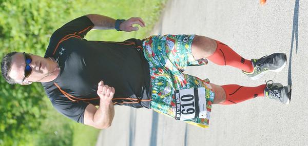WARREN DILLAWAY / Star Beacon<br /> MATT DEERING of Geneva finishes the Greenway Five Mile on Saturday in Austinburg Township.