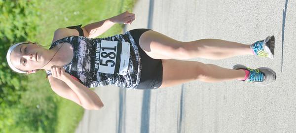 WARREN DILLAWAY / Star Beacon<br /> EMILY DEERING of Geneva wins the Greenway Five Mile on Saturday in Austinburg Township.
