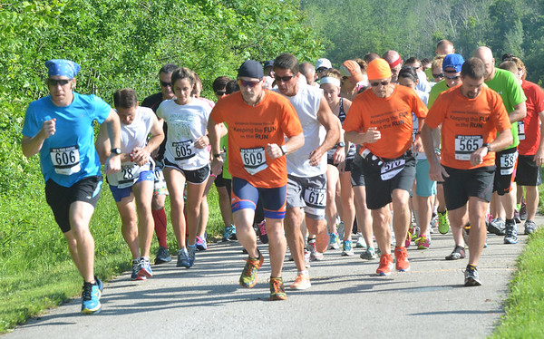 WARREN DILLAWAY / Star Beacon<br /> LUKE STECKI of Ashtabula (far left) breaks to the front of the Greenway Five Mile on Saturday in Austinburg Township. he went on to win the race.