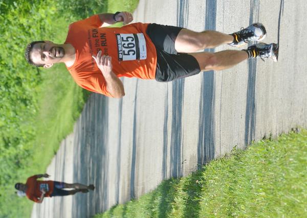 WARREN DILLAWAY / Star Beacon<br /> ERIK van't Veer of Ashtabula finishes the Greenway Five Mile on Saturday in Austinburg Township.