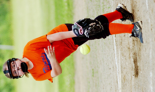 WARREN DILLAWAY / Star Beacon<br /> SARA DRAKE of the Kingsville Minor League Tigers pitches on Monday during a game with the Pymatuning Area Youth Organization Panthers in Andover.