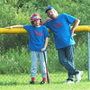 WARREN DILLAWAY / Star Beacon<br /> JOHN BURFORD (right), coach of the Minor League Williamsfield Cubs, waits for an Andover Mets pitcher to warm up with on-deck btter Austin Musgrave Monday evening in Williamsfield Township.