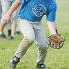 WARREN DILLAWAY / Star Beacon<br /> KENNY CROUCH blows a bubble while fielding a ground ball during Pymatuning Area Youth Organization Minor League All Star practice Monday in Andover.