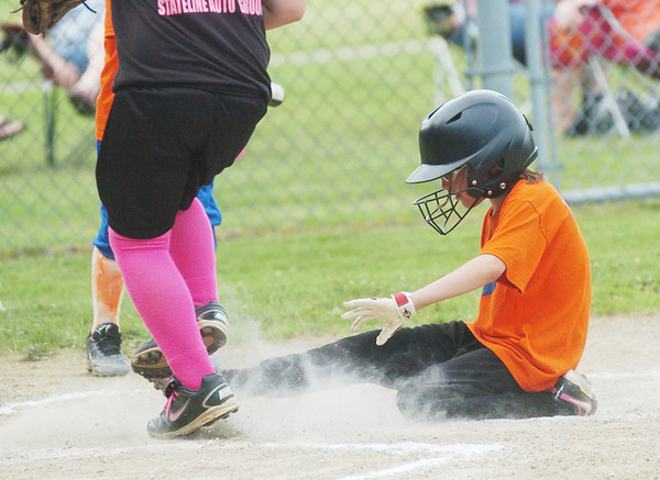 WARREN DILLAWAY / Star Beacon<br /> ASPEN THOMAS of the Kingsville Minor League Tigers slides safely home during a game with the Pymatuning Area Youth Organization Panthers on Monday evening in Andover.