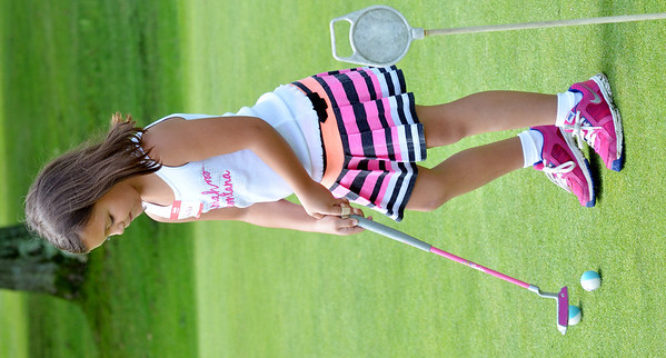 WARREN DILLAWAY / Star Beacon<br /> CHELSEA CARUSO, 6, of Ashtabula, works on her putting at the Hickory Grove Junior Golf Clinic on Tuesday in Jefferson Township.