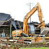 WARREN DILLAWAY / Star Beacon<br /> HEAVY EQUIPMENT is used to tear down the Eighmy Corporation building at the intersection of Maple and Reig roads in Conneaut Tuesday afternoon.