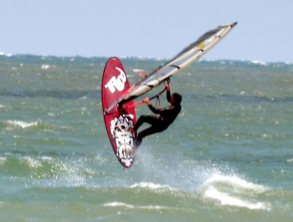 WARREN DILLAWAY / Star Beacon<br /> A WIND surfer gets some air whle working Lake Erie just off Conneaut Township Park beach on Tuesday afternoon.