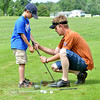 WARREN DILLAWAY / Star Beacon<br /> MARK WHITSETT, an instructor at the Hickory Grove Jr. Golf Clinic, adjusts the grip of Devin Chiacchiero, 8, of Jefferson on Tuesday in Jefferson Township.