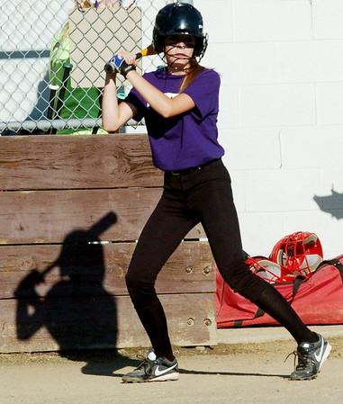 WARREN DILLAWAY / Star Beacon<br /> BOBBI HUGHES warms up before batting for Western Reserve during a senior league game at the Jefferson Area Girls Softball complex.