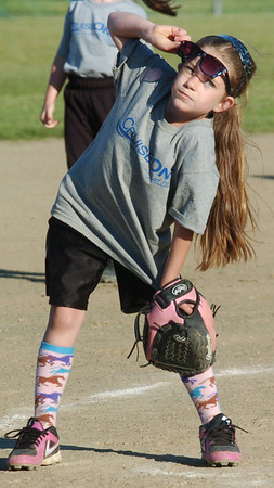 WARREN DILLAWAY / Star Beacon<br /> MIKENZIE BROWN  of Cruise One makes sure she can see the ball during a Mini Minor game at the Jefferson Area Girls Softball complex.