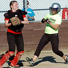 WARREN DILLAWAY / Star Beacon<br /> CAITLIN SUKALAC (right) of Western Reserve scores as Morgan Sanner (left) of Collucci's Pizza looks to the pitcher on Tuesday evening at the Jefferson Area Girls Softball complex.