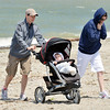 WARREN DILLAWAY / Star Beacon<br /> RYAN AND Lisa Adams of Erie walk with son Will, eight months, at Conneaut Township Park beach on Tuesday.