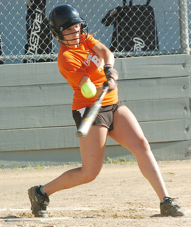 WARREN DILLAWAY / Star Beacon<br /> TAYLOR JOHNSTON of Thorne's Bi Lo takes a mighty swing on Tuesday during a senior league game at Jefferson Area Girls Softball complex.