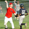 WARREN DILLAWAY / Star Beacon<br /> NATHAN HALL (left) of the Saybrook Major League Indians throws home after forcing Javaun Whitted of the Rays at first base on Monday.