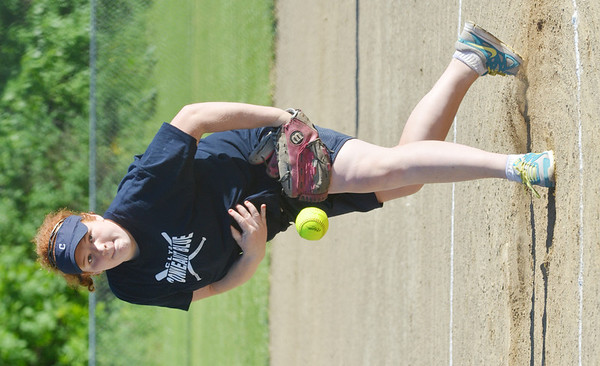 WARREN DILLAWAY / Star Beacon<br /> EMILY MARTIN of the Conneaut Blue Major League team pitches on Monday night during a game with the Pymatuning Phillies at Skippon Park in Conneaut.