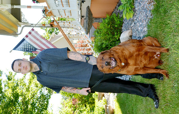 WARREN DILLAWAY / Star Beacon<br /> ROBERT HARDEE poses with his dog Bear at 930 Main Street in Conneaut where a yard sale will be held Saturday to benefit the Animal Protective League and other animal agencies.