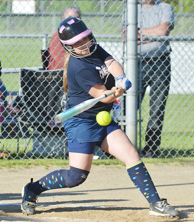 WARREN DILLAWAY / Star Beacon<br /> HANNAH HUNT of the Conneaut Blue Major League team swings on Monday evening during a game with the Pymatuning Phillies at Skippon Park in Conneaut.