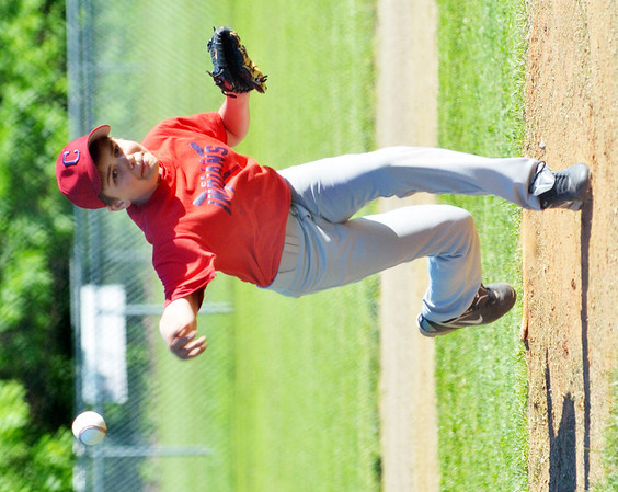 WARREN DILLAWAY / Star Beacon<br /> ETHAN KNIGHT pitches for the Conneaut Major League Indians on Monday night at Skippon Park in Conneaut during a game with the Kingsville Red Sox.