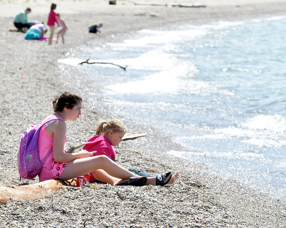 WARREN DILLAWAY / Star Beacon<br /> ALLIEY ROSE, 13, (left) and Kente Goudge, 7, both of Ashtabula, enjoy a day of fun at Walnut Beach on Tuesday afternoon in Ashtabula.