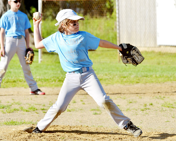 WARREN DILLAWAY / Star Beacon<br /> LUCIANO COSTELLO of the Geneva Minor League Cyclones pitches on Tuesday during a game with the Prospectors at Ed Ticknor Memorial Field in Austinburg Township.