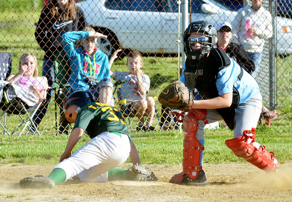 WARREN DILLAWAY / Star Beacon<br /> TED COLEMAN of the Geneva Minor League Prospectors scores a run on Tuesday during a game with the Geneva Cyclones as Terry Miller of the Geneva Cyclones follows through on a late tag at Bob Ticknor Memorial Field in Austinburg Township.