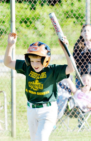 WARREN DILLAWAY / Star Beacon<br /> TED COLEMAN of the Geneva Minor League Prospectors celebrates after scoring a run on Tuesday during a game with the Geneva Cyclones at Bob Ticknor Memorial Field in Austinburg Township.