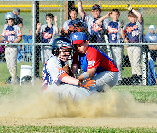 WARREN DILLAWAY / Star Beacon<br /> DAVE PIPINGER (left) of the Grand Valley Major League Tigers slides safely into second base colliding with Scott Ellsworth of the Grand Valley Nationals on Tuesday night at Community Park in Orwell.