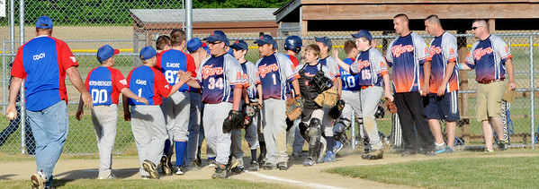 WARREN DILLAWAY / Star Beacon<br /> MEMBERS OF the Grand Valley Tigers Major League team (right) and the Grand Valley Nationals shake hands on Tuesday after a game at Community Park in Orwell.