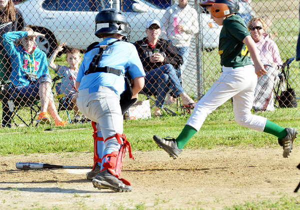 WARREN DILLAWAY / Star Beacon<br /> TED COLEMAN of the Geneva Minor League Prospectors scores a run on Tuesday during a game with the Geneva Cyclones as Terry Miller of the Geneva Cyclones prepares to apply a late tag at Bob Ticknor Memorial Field in Austinburg Township.