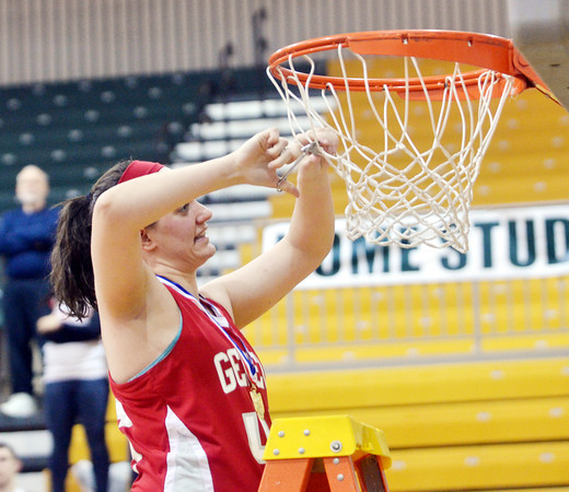 WARREN DILLAWAY / Star Beacon<br /> ANNALIESA FISTEK of Geneva cuts a portion of the net on Friday night after the Eagles won the Division II district championship at Lakeside.