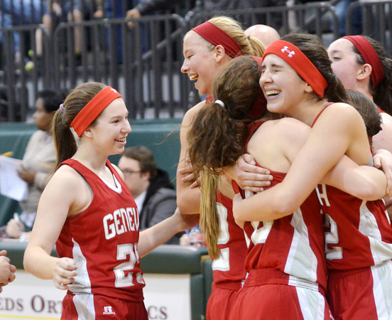 WARREN DILLAWAY / Star Beacon<br /> MEMBERS OF the Geneva girls basketball team react after defeating East Tech on Friday night during a Division II district championship game at Lakeside.  Emily Ball (far right) hugs teammate Rachael Harrington with Courtney Harriman (far left) and Lindsey Mayle (middle) celebrate the championship.