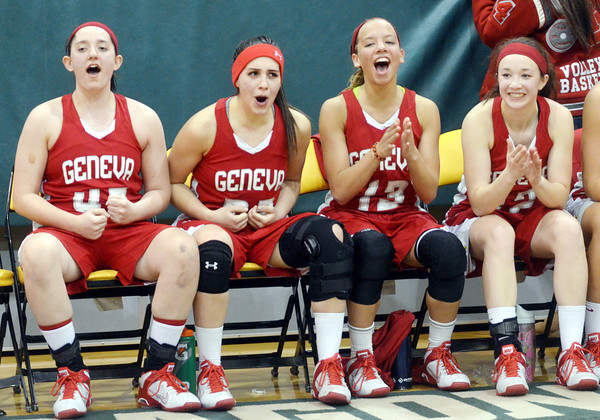 WARREN DILLAWAY / Star Beacon<br /> MEMBERS OF the Geneva girls basketball team react after defeating East Tech on Friday night during a Division II district championship game at Lakeside. (From left) Annaliesa Fistek, Emily Ball, Lindsey Mayle and Alyssa Scott.