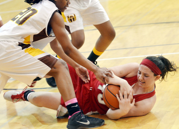 WARREN DILLAWAY / Star Beacon<br /> ANNALIESA FISTEK (with ball) of Geneva hits the deck as Corrine Caldwell (20) of East Tech defends during Division II district chaaampionship action on Friday at Lakeside.