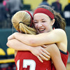 WARREN DILLAWAY / Star Beacon<br /> ALYSSA SCOTT (facing) of Geneva hugs teammate Lindsey   Mayle after winning the Division II district championship against East Tech on Friday night at Lakeside.