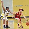 WARREN DILLAWAY / Star Beacon<br /> ALYSSA SCOTT of Geneva dribbles up court with Tionna Barnes of East Tech defends on Friday night during Division II district championship action at Lakeside.