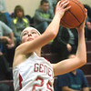 WARREN DILLAWAY / Star Beacon<br /> EMILY O'DELL of Geneva drives to the basket on Thursday night during Division II District Semi-final action at Pymatuning Valley.