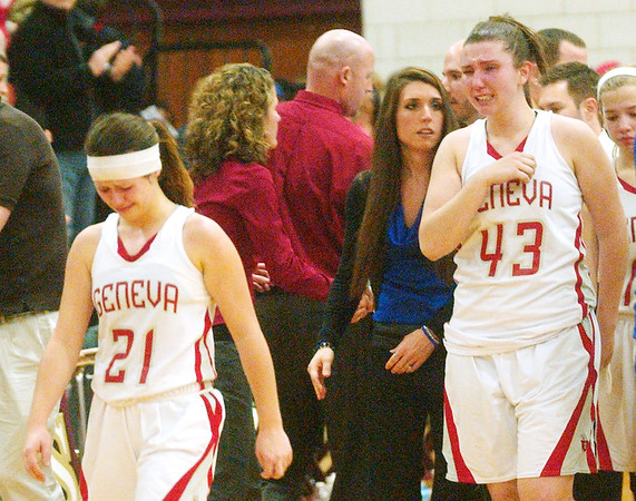 WARREN DILLAWAY / Star Beacon<br /> BECKY DEPP (21) and Geneva teammate Natalie Thomas walk off the court dejected after losing a Division II District Semi-final game to Lakeview on Thursday night at Pymatuning Valley.