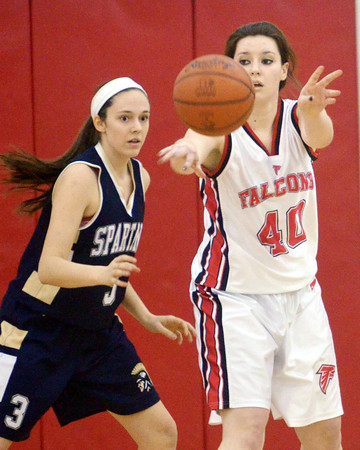 WARREN DILLAWAY / Star Beacon<br /> SARAH BROOK of Jefferson (40) passes to a teammatte while Natalie Bertolasio of Conneaut defends on Tuesday night during the Star Beacon-Ed Batanian Senior Classic at Jefferson.