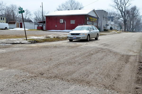 WARREN DILLAWAY / Star Beacon<br /> CONNEAUT STREET crews fixed a pothole that caused a Conneaut Area City Schools bus to get stuck on Monday afternoon near the intersection of Harbor Avenue and 14th Street.
