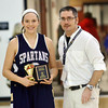 WARREN DILLAWAY / Star Beacon<br /> NATALIE BERTOLASIO of Conneaut receives the three point contest plaque from Star Beacon sports writer Bob Ettinger on Tuesday night after the Star Beacon-Ed Batanian Senior Classic at Jefferson.