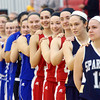 WARREN DILLAWAY / Star Beacon<br /> BROOKE BENNETT (12) of Conneaut and her   Star Beacon-Ed Batanian Senior Classic teammates listen to the National Anthem on Tuesday night at Jefferson High School.