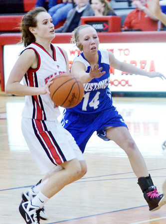 WARREN DILLAWAY / Star Beacon<br /> COLEEN O'CONNOR of Jefferson drives to the baaasket with  Chelsea Stehlik of Grand Valley defending (14)  on Tuesday night during the Star Beacon-Ed Batanian Senior Classic at Jefferson High School.