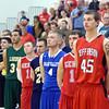 WARREN DILLAWAY / Star Beacon<br /> WYATT WEYHMELLER (45) and his Star Beacon-Ed Batanian Senior Classic teammates listen to the National Anthem on Tuesday night at Jefferson High School.
