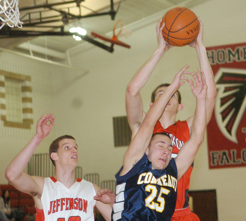 WARREN DILLAWAY / Star Beacon<br /> KYLE SPRINKLE (25) of Conneaut leaps for the ball with Wyatt Weyhmeller (back) and David Chase, both of Jefferson, on Tuesday night during the Star Beacon-Ed Batanian Senior Classic at Jefferson.