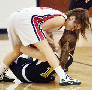 WARREN DILLAWAY / Star Beacon COLEEN O'CONNOR (top) of Jefferson wrestles for the ball with Erin Fahl of Riverside on Tuesday night during the Star Beacon-Ed Batanian Senior Classic at Jefferson High School.